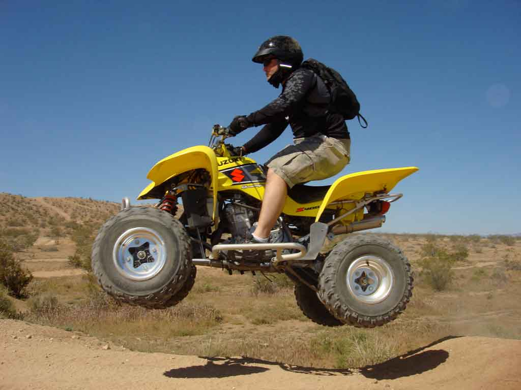 An OHV in action near California City, CA.  This part of the Mojave is criss-crossed with hundreds of motorcyle paths and roads created by off-road vehicles driving unfettered over the desert terrain.  Their tire tracks destroy the fragile desert top soil––destroying vegitation and the habitat of animal life.